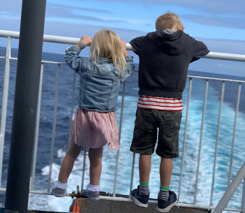children on ferry deck on holiday