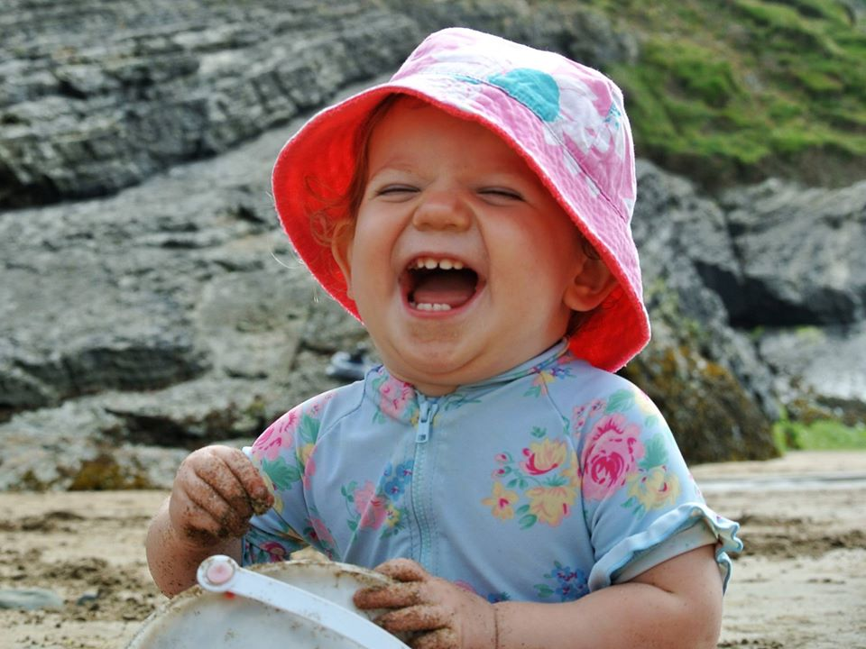 Child on beach in Wales